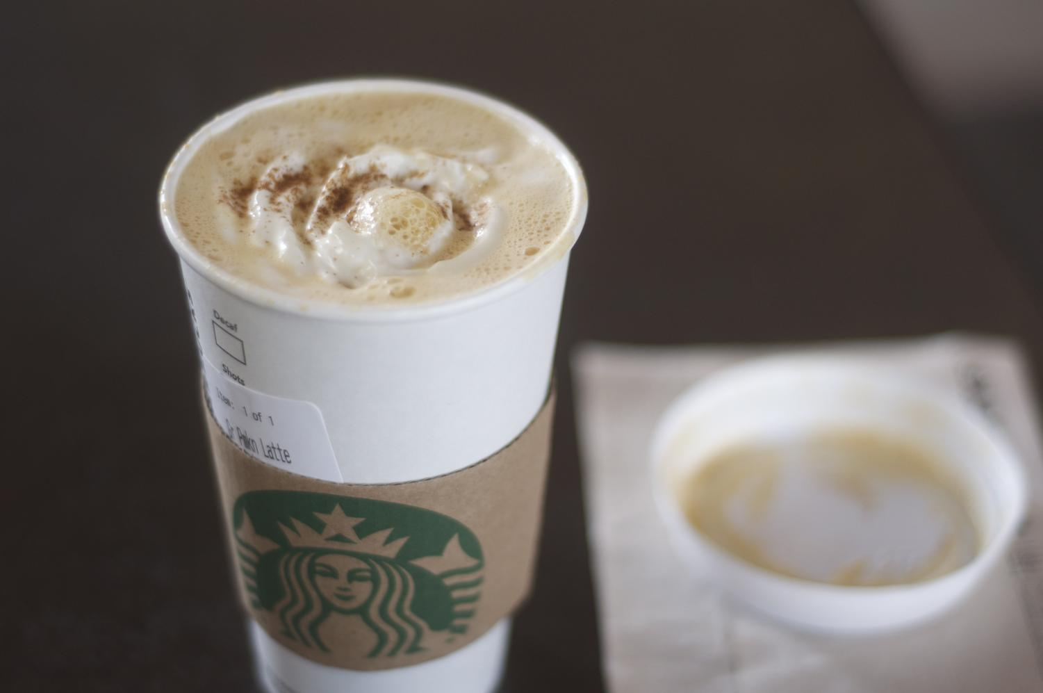 The infamous PSL from Starbucks shown to be seasonal with a dash of cinnamon on top of the drink.