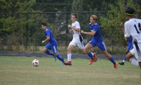 Mateo Noguera (right, blue) has been playing soccer since he was three years old. Now as a senior captain, Noguera still shines on the field.