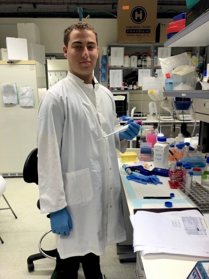 Dressed+up+in+his+white+lab+coat+and+blue+gloves%2C+Nathan+Slotnik+makes+the+most+of+his+SciTech+Scholarship+as+he+holds+a+micropipette+in+the+laboratory%2C+ready+to+contribute+to+finding+a+cure+for+Duchenne+muscular+dystrophy.