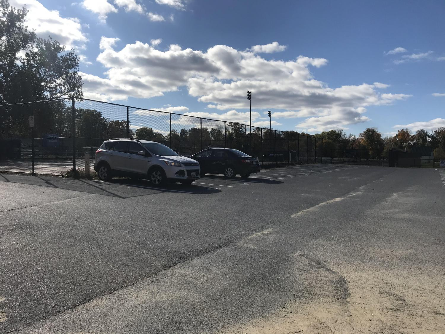 On Nov. 1, only two cars sit in the senior parking lot.  Nov. 1 2019 was senior skip day and very few seniors showed up to classes.