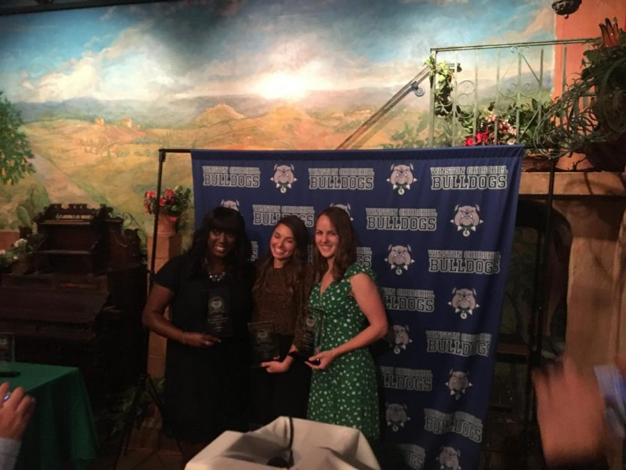 Former track student-athletes (left to right) Audrey M. Gariepy-Bogui, Louise Hannallah Bayly and Erin McManus pose together with their Athletics Hall of Fame trophies.