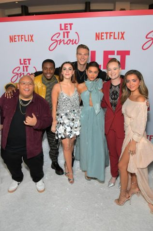 "The cast of Netflix Original ""Let it Snow"" poses for a photo at the premiere. The movie is based on the book by authors John Green, Maureen Johnson, and Lauren Myracle"