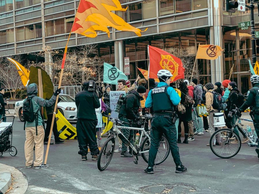 The organization Extinction Rebellion holds a climate strike outside the World Bank in Washington DC. Many students have become climate activists over the decade and attend these protests.