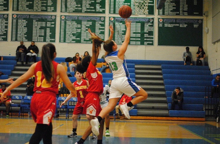 Senior Katie Stanish shoots a lay-up in a game against Wheaton. This is her fourth year on varisty basketball and she is excited for the 2019-2020 season.