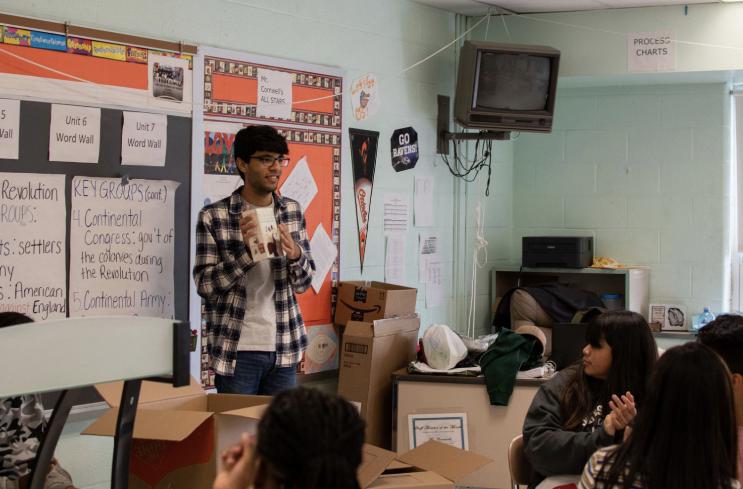 WCHS senior Robin Bali travels to Lakeland Elementary School Middle School in Baltimore, Md. to deliver books and other supplies. In the photo, Bali is giving a presentation to students that attend this school and is extremely grateful for their reactions.