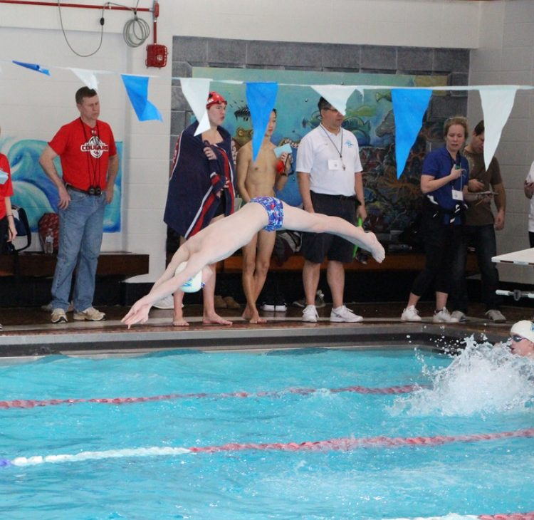 Junior Cameron Barclay exhibiting his athletic skill with a graceful swan dive to start the race.