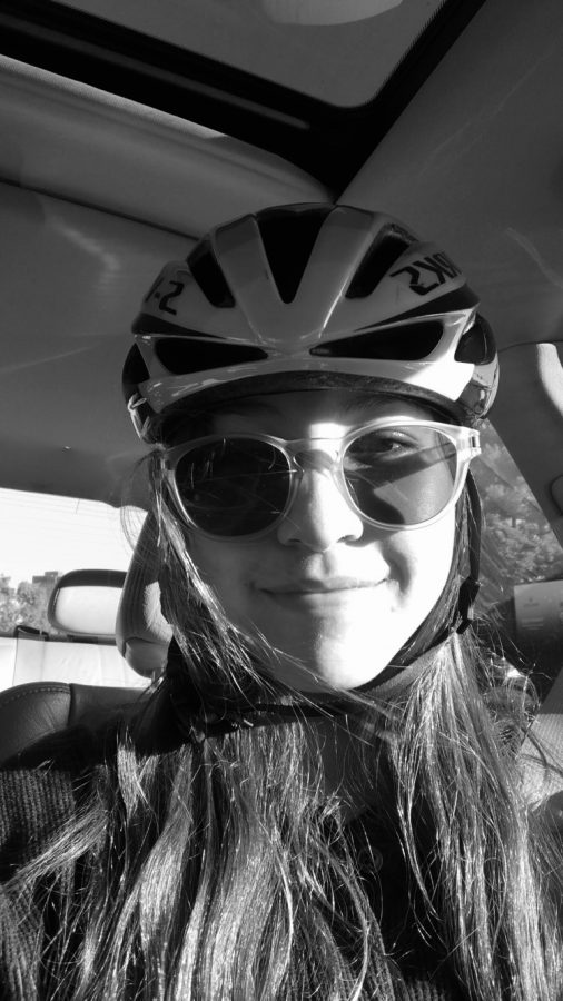 +Stephanie+Zoltick+wears+her+helmet+before+a+bike+ride.+Zoltick+prioritizes+safety+and+knows+the+consequences+of+riding+without+a+helmet.