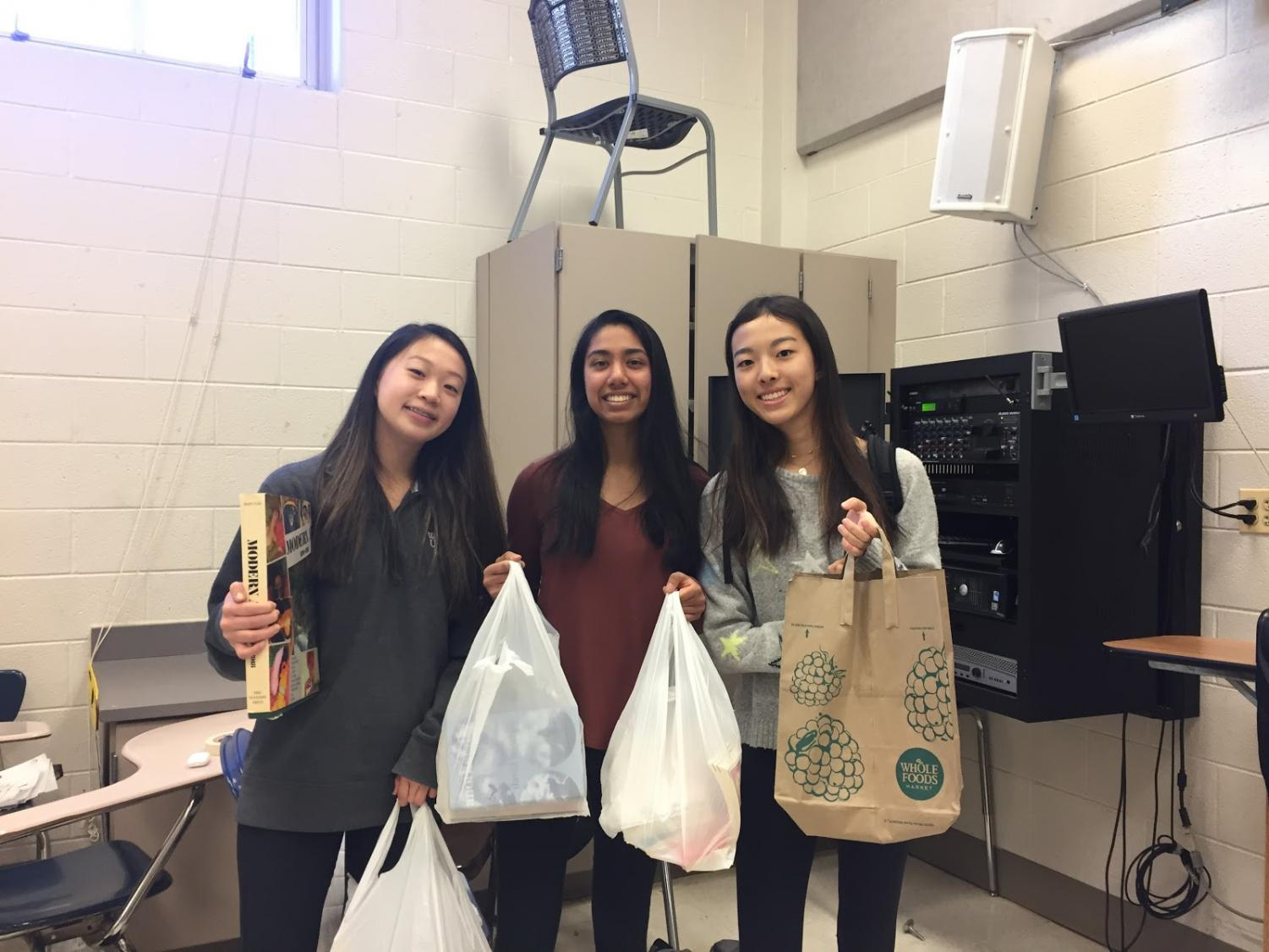 Sophomore Jessica Lin and her friends attended the EHS' fourth annual book fair. Lin bought ten books./Photo 2: Students browse the books at the EHS Book Fair. There were many different genres of books including fantasy, historical fiction and test-prep books.
