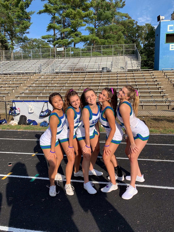 Varsity cheerleading captains Kathy Hu, Cat Gilligan, Danielle Probert, Ally Salzberg and Peyton Kanstoroom help run practices and promote teamwork throughout the seaon.