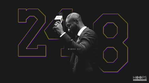 A hoops poster of the basketball star Kobe Bryant with both of his jersey numbers, eight and 24.