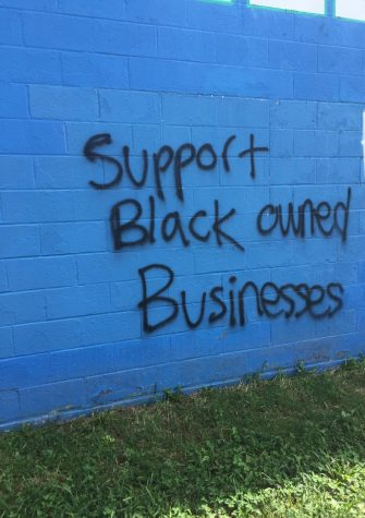 """Support Black owned bussinesses"" was spray-painted on a building at the track at Winston Churchill High School in Potomac, MD on Septmeber 5, 2020."