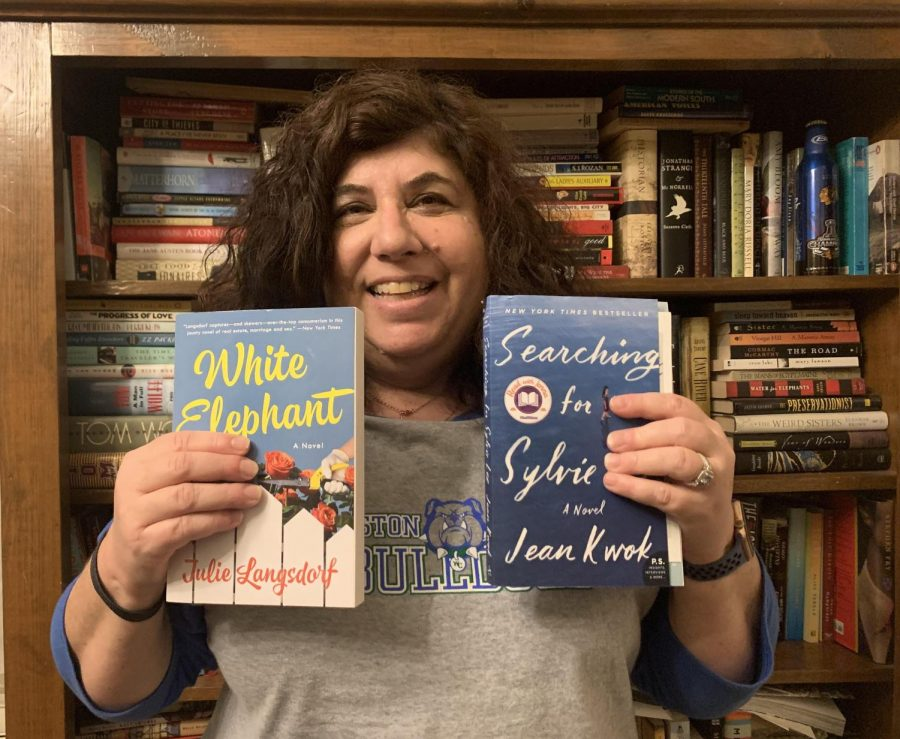 Deli poses with the 2 books she got in the mail. A book lover who owns over a hundred books, she was super excited to receive and read books she does not own yet.