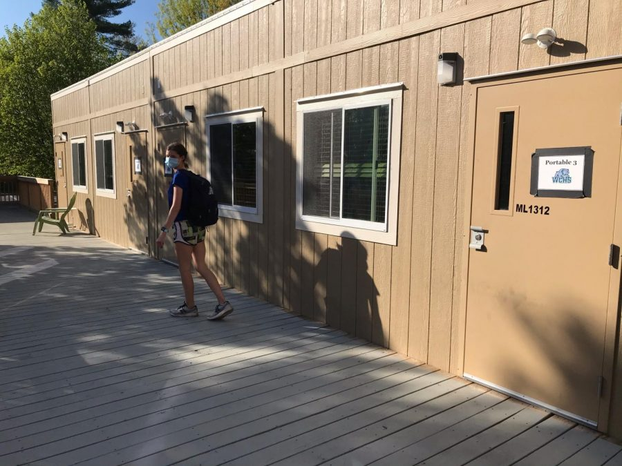 At+WCHS%2C+sophomore+Sydney+Willich+walks+to+her+class+in+Portable+3.+Portables+are+a+new+addition+to+WCHS+this+year+to+accommodate+all+students.+