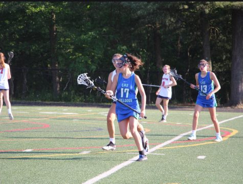 Lexie Levitt runs past defenders on her way to scoring a goal for the WCHS JV Lacrosse Team.