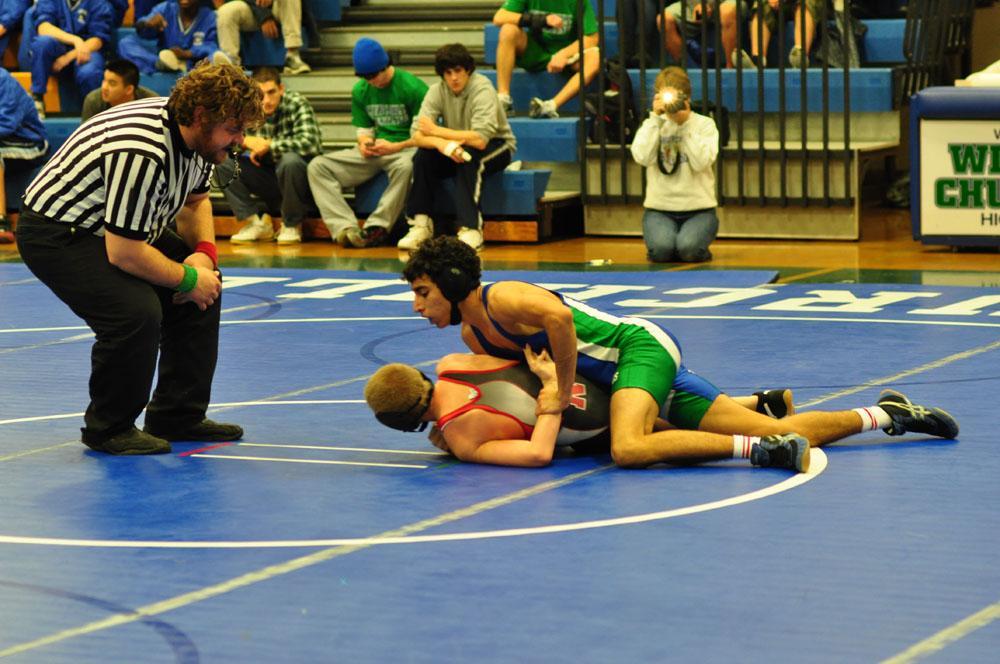 Junior Rustin Tashayyod grapples with a Northwood opponent Dec. 7.