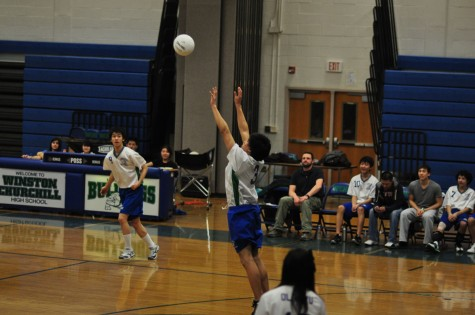 Junior Chris Woo sets the ball in a scrimmage. The boys team has found itself with a considerably younger roster than last season.