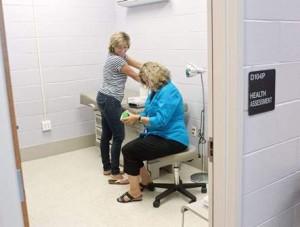 Health techs Beth Jordan and Cheryl Jones set up the Gaithersburg center.