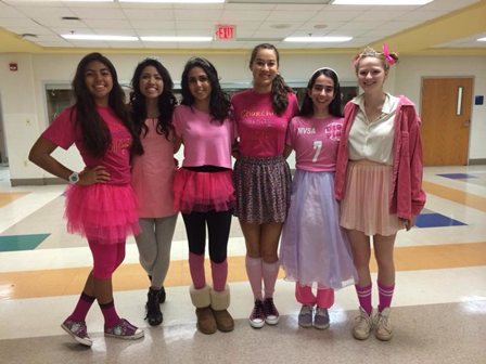 The volleyball team dresses as fairies to support breast cancer awareness.