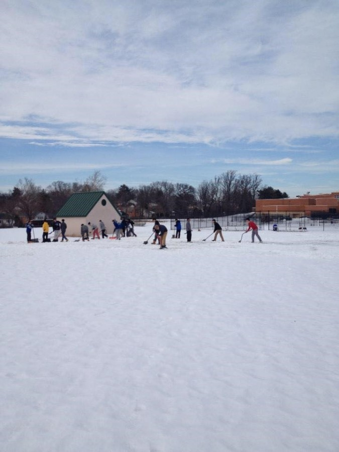 In preparation for tryouts Feb. 28, boys lacrosse players shoveled their practice field Feb. 25, only to have school closed the next day due to snow.