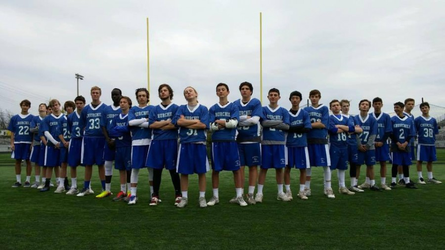 The JV boys lacrosse team poses for a picture after finishing their season 9-0
