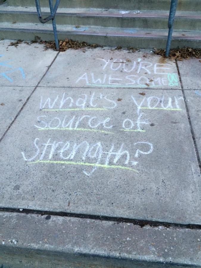 SOS peer leaders, led by social studies teacher Jamie Frank, wrote positive messages outside the school to inspire students. The eight sources of strength refer to family support, generosity, healthy activities, medical access, mental health, mentors, positive friends and spirituality.