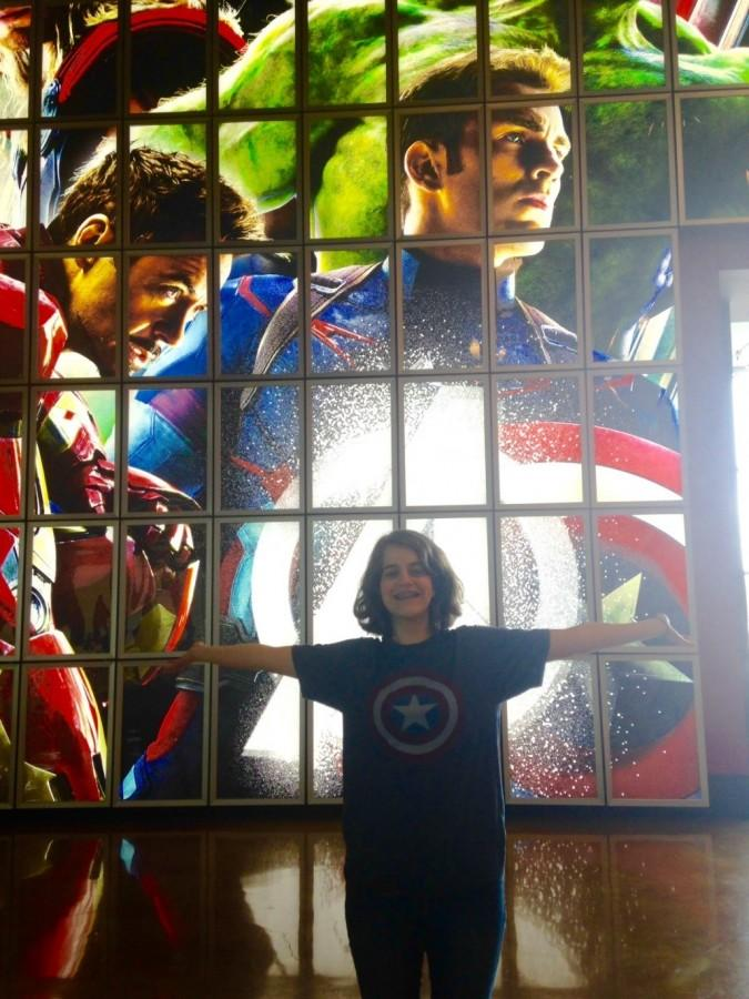 Senior Christina Hnatov in front of the Arclight display for Age of Ultron.
