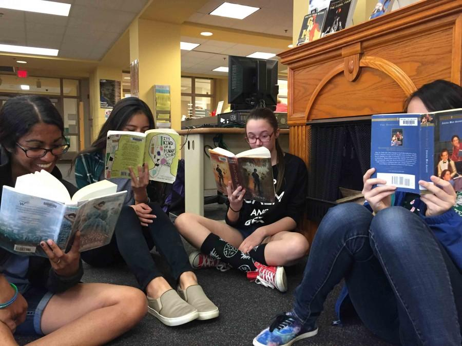 Students+gather+together+to+enjoy+their+favorite+books%2C+new+and+old.