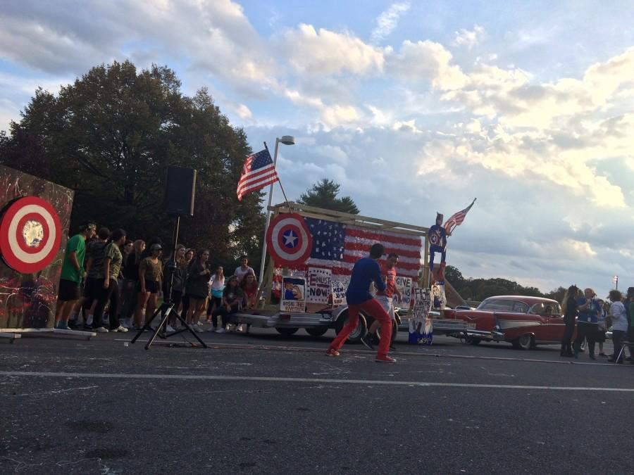 Juniors show off their Captain America float before the football game