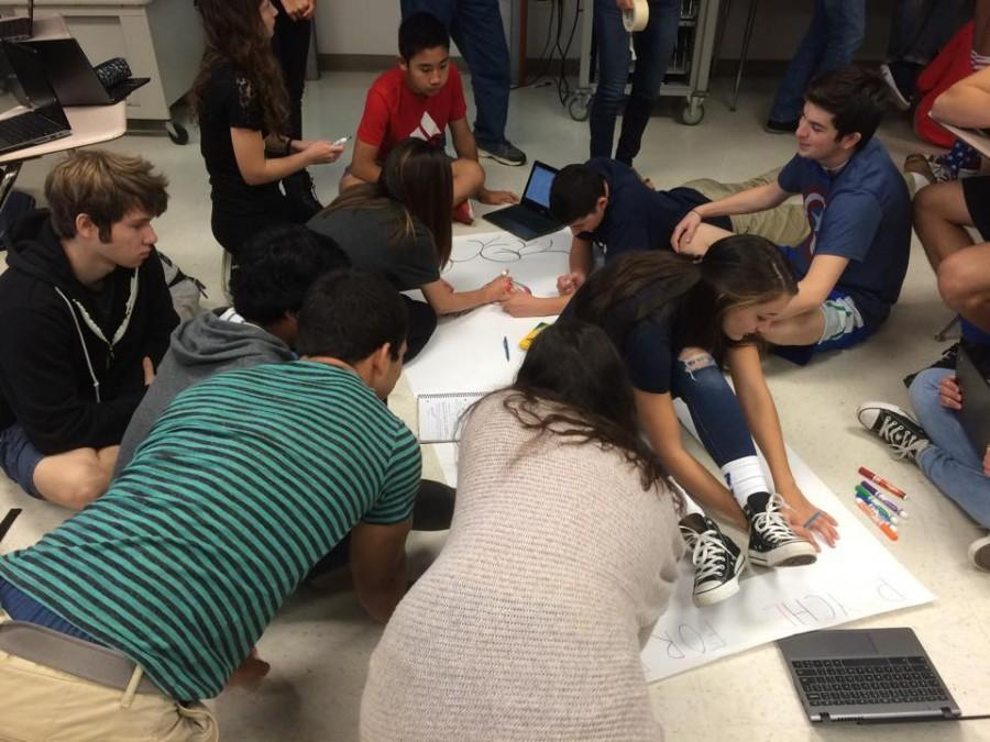 AP Psych students work on their door design during class