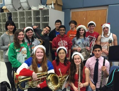 Band members participate in the yearly winter tradition of caroling around school during the last day before winter break.