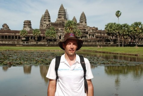 Forney poses in front of a temple in Southeast Asia.