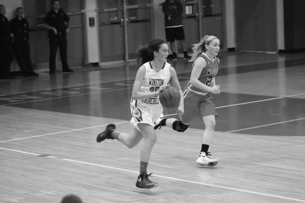 Kuchins dribbles the ball down the court during a recent game. She has led the team to a 14-4 record.