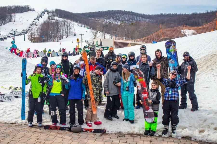 The Bryce ski team poses as a group at the top of the slopes at the Whitetail resort.  School ski clubs would have similar experiences traveling to ski resorts and skiing as a group.