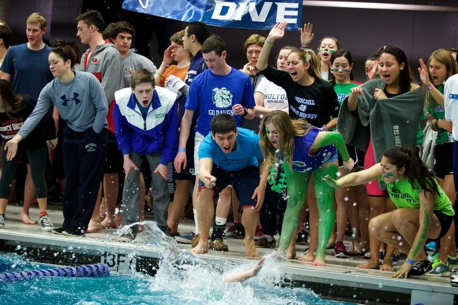 The swim and dive team cheers during the swimming finals at Metros