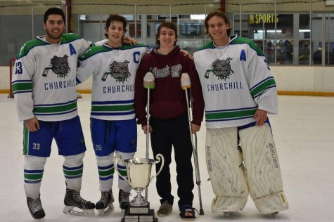 Senior Philip Satin (second from left), joined by seniors Zach Ruvo, Charlie Butler and Markus Hurd.