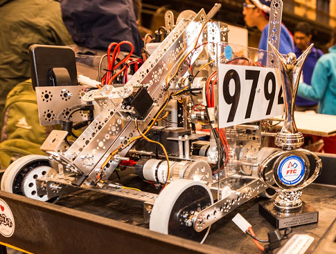 The team's robot climbs up the ramp during the competition.