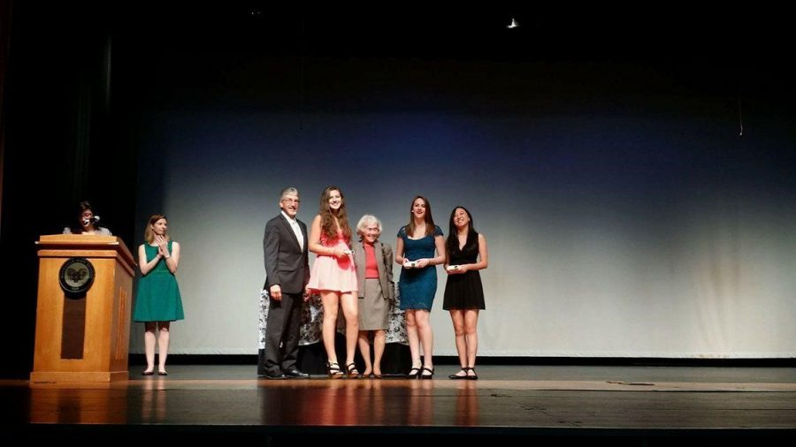 Superintendent Bowers presents seniors Natalie Hwang, Anna Votaw and Valerie Weitz with awards for theater excellence