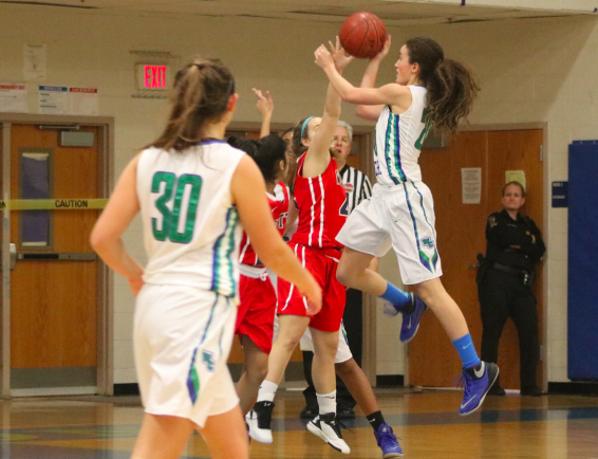 Kuchins jumps against a defender for a layup