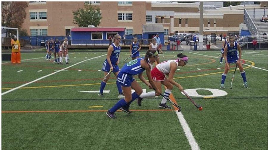 Sophomore Alexandra Sperling, junior Faith Kean and senior Jocelyn Kelley play offense.