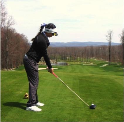 Junior Lena Capoccia hits a tee shot.