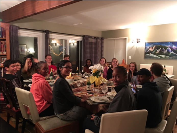 Exchange students and their hosts enjoy a 'family' dinner together.