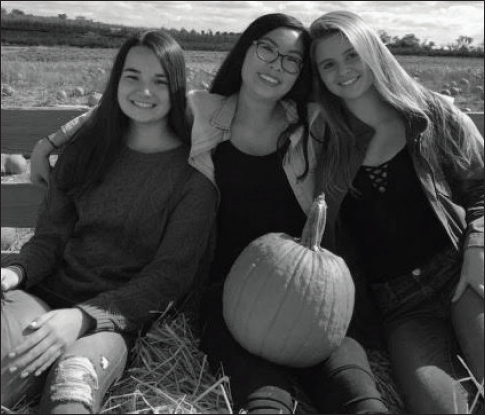 Sophomores Jetta Chen, Rebecca Hu and Caroline Wallerstedt take a hayride to the pumpkin patch at Homestead Farm. In the fall, Homestead Farm also offers several varieties of apples.