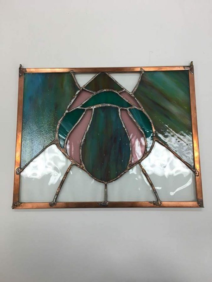 Joelle+Goldberg+created+a+stained+glass+piece+for+last+year%E2%80%99s+Consensus+chain.+The+theme+was+the+Montgomery+County+Agricultural+Fair.+%0A