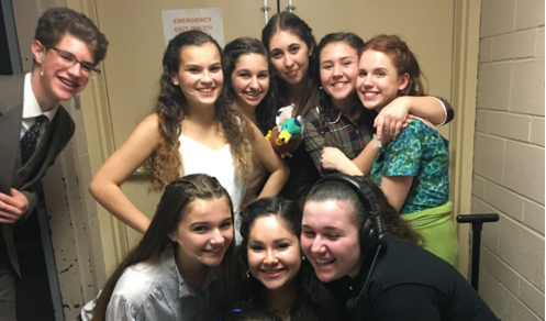 Pictured: Heather Kirschner (bottom left) and junior Josie Weinberg (top right) pose with castmates during Ovations Theater's December performance of Spring Awakening.