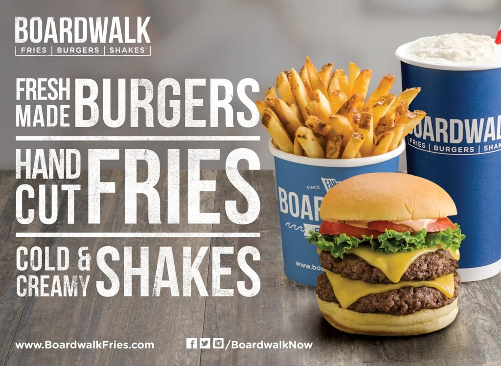A poster advertises the new Boardwalk restaurant that just opened in Montgomery Mall.