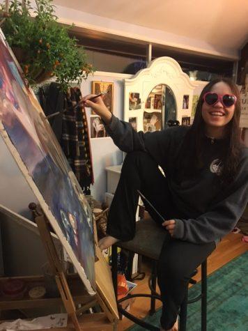 Senior Bridgette Warner poses with her next masterpiece.