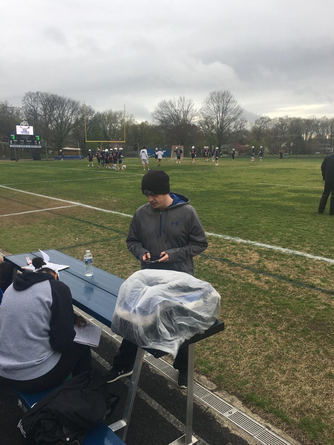 Kevin Hauschild prepares for a lacrosse game. Hauschild managed clock operations for many CHS sports and looks to apply the lessons he has learned from this experience to a career as a police officer.