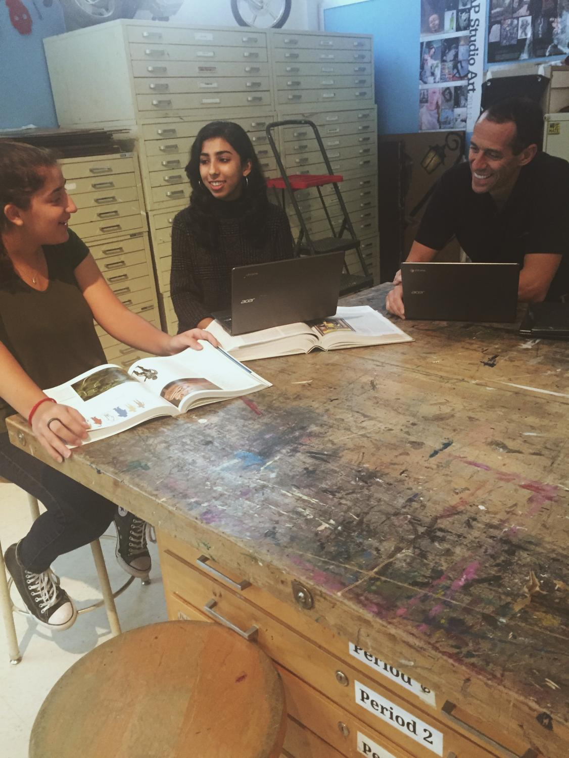 Juniors Nura Dhar and Leah Stein, along with art teacher Paul Dermont discuss plans to create a new arts course at CHS next year. The course will have lessons and Socratic-seminar type discussions.