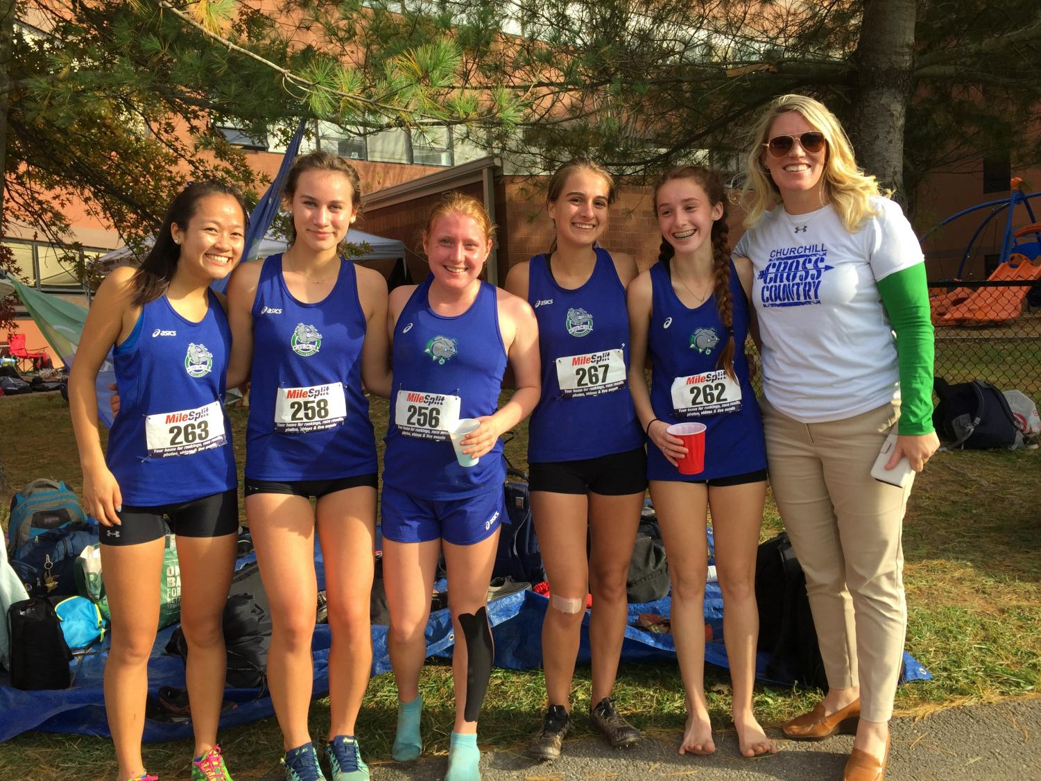 WCHS girls XC runners Lauren Kuo, Jessica Bowen, Lauren Anderson, Laura Sneller and Bridget Kelly pose with Ms. Heckert after a race.