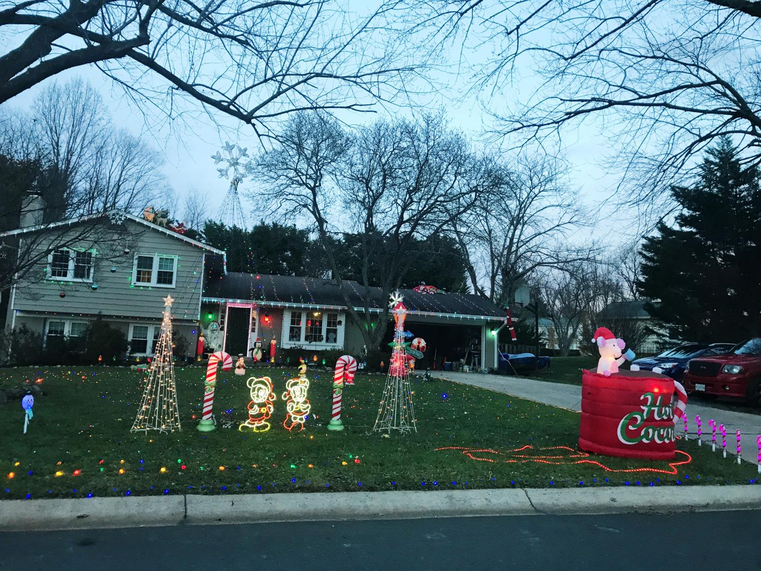 The Fenton family puts up lights and decorations on their lawn, roof and in front of their house to get into the holiday spirit.